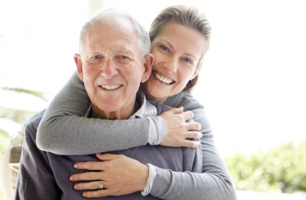 Closeup portrait of a beautiful young woman embracing his father over white background