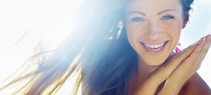 Closeup of a beautiful smiling young woman