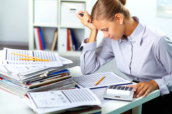 Portrait of a young businesswoman working with papers in office