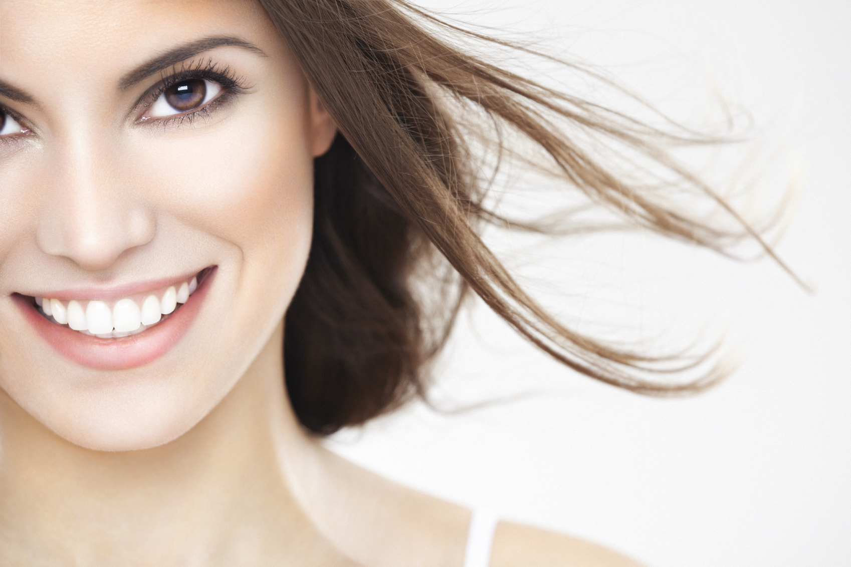 How To Achieve A Brighter & More Beautiful Smile